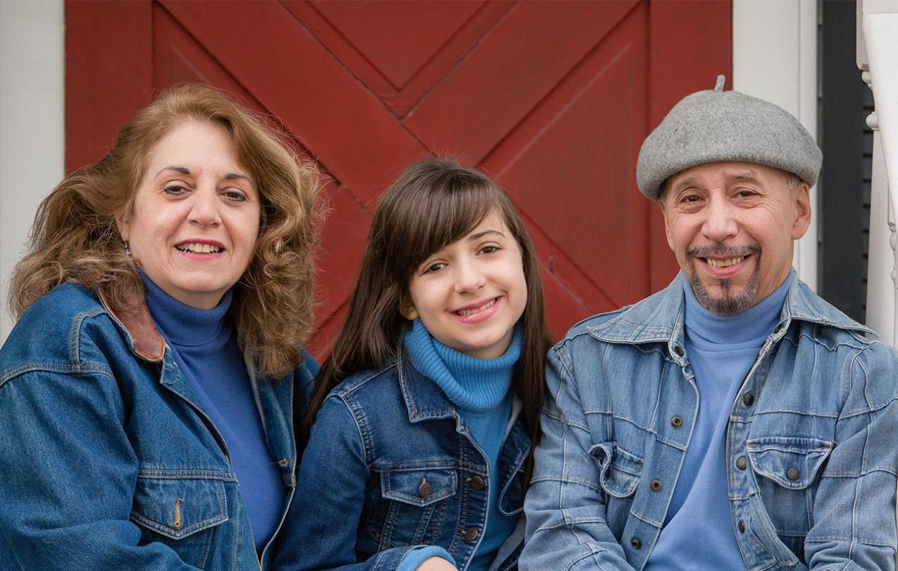 An image of parents and child smiling.